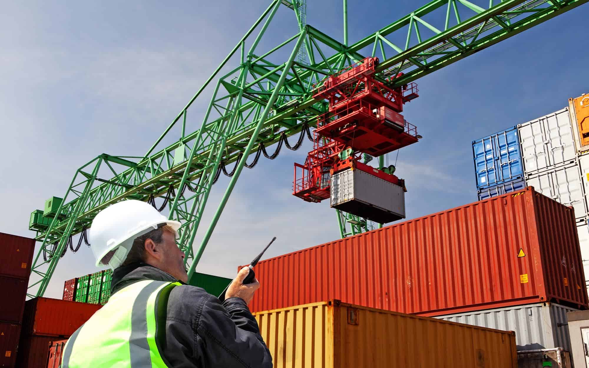 Man Watching Freight Containers Being Forwarded | FW Logistics